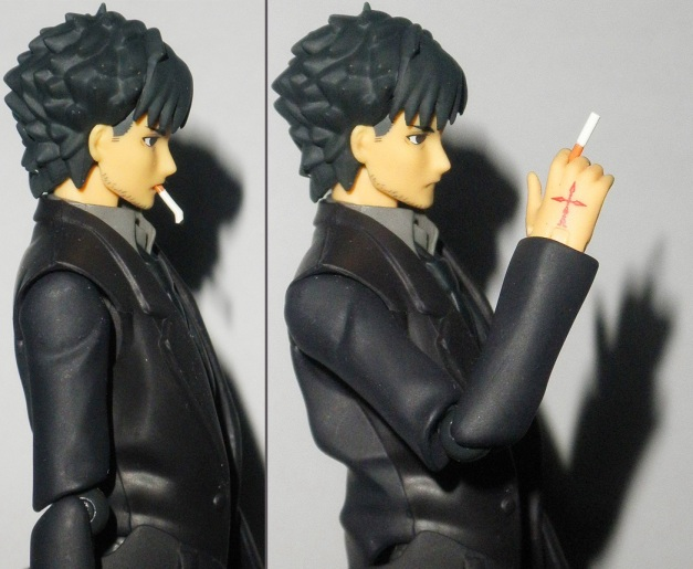Smoking & holding his cigarette