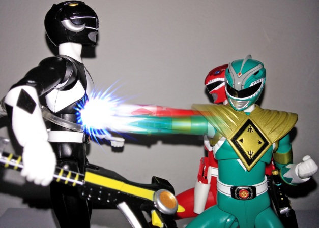 """Red Ranger: """"Beat it, Japanese goody two shoes!"""" Green Ranger: """"You're no match for a legend!! Zack or should I call you Adam?!"""""""